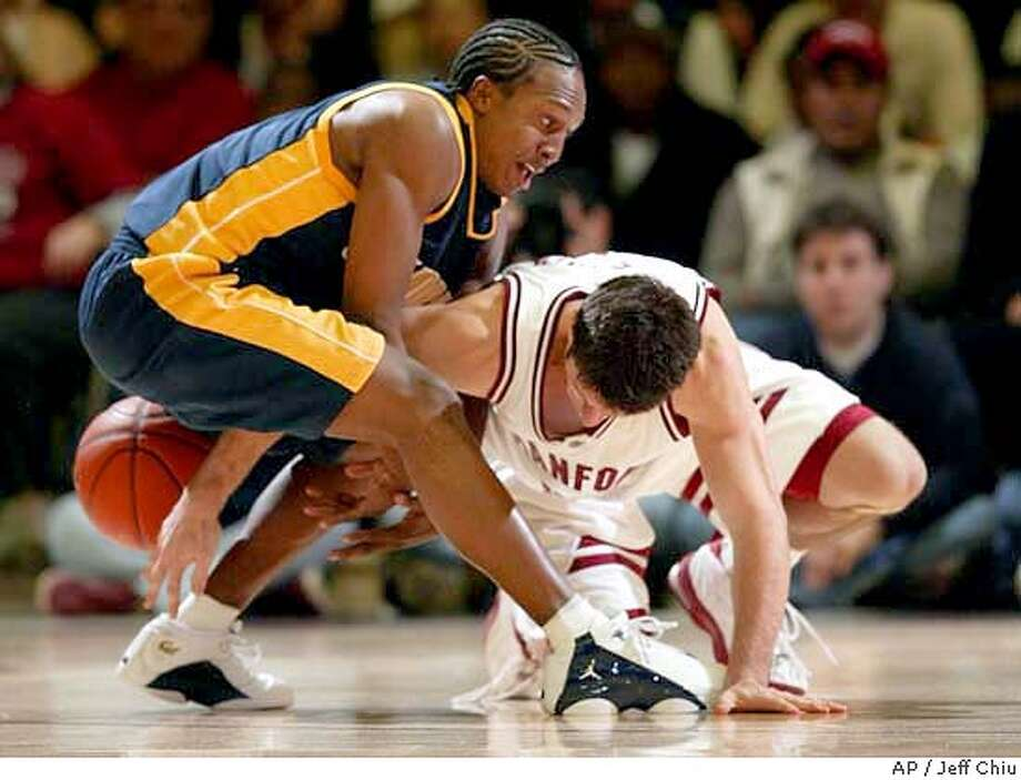 California's A.J. Diggs, left, and Stanford's Chris Hernandez get tangled up as they fight for a loose ball in the second half on Saturday, Jan. 17, 2004 in Stanford, Calif. Stanford won 68-61. (AP Photo/Jeff Chiu) Photo: JEFF CHIU