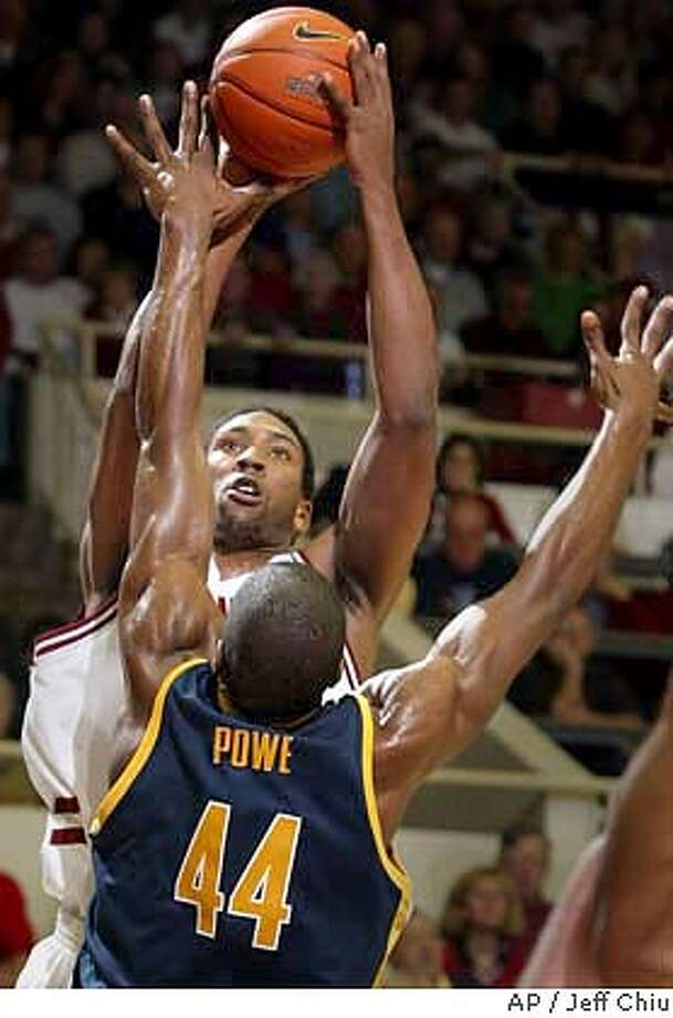 Stanford's Justin Davis attempts a shot as California's Leon Powe defends in the first half on Saturday, Jan. 17, 2004 in Stanford, Calif. (AP Photo/Jeff Chiu) Photo: JEFF CHIU