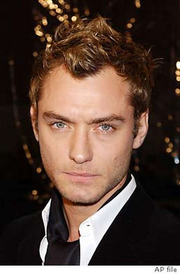 "** FILE ** Actor Jude Law arrives at the premiere of the film ""Cold Mountain"" at the Mann National Theater in Los Angeles, on in this Dec. 7, 2003 file photo. Law says he's emerged stronger and happier from his bruising breakup with Sadie Frost. Law, who stars with Nicole Kidman and Renee Zellweger in the film ""Cold Mountain,'' said Wednesday, Jan. 14, 2004 that events such as a divorce ``take a lot longer to heal and repair and to put back into order. (AP Photo/Tammie Arroyo) Photo: TAMMIE ARROYO"