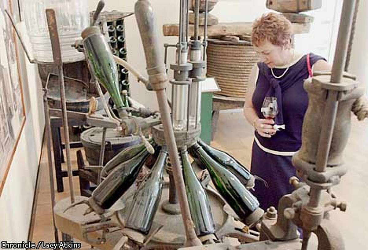 Sandi Borreson looks over the antiques in the Artesa Winery, June 6,02, in Napa. PHOTO BY LACY ATKINS/CHRONICLE