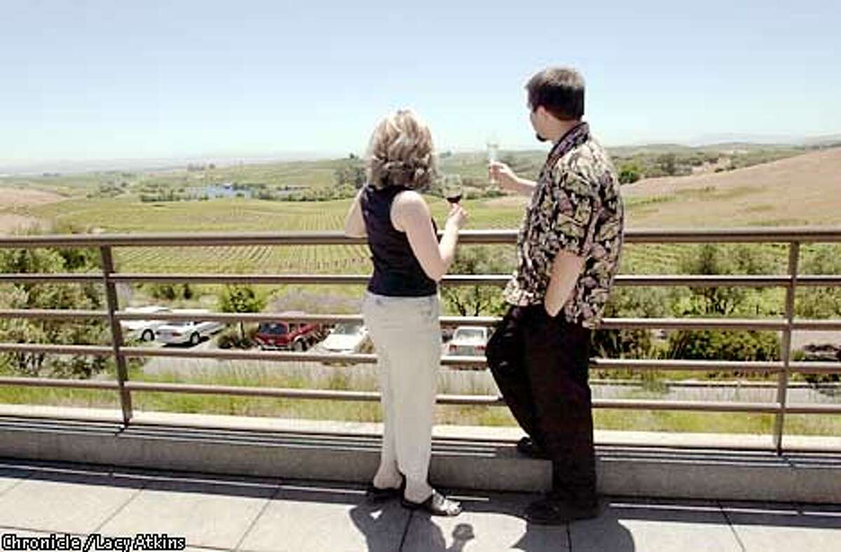 Jenny Grundstrom and Jonathan Wright enjoy the view of vineyards from the Artesa Winery as they sip the wines from the winery, June 6,02, in Napa. PHOTO BY LACY ATKINS/CHRONICLE