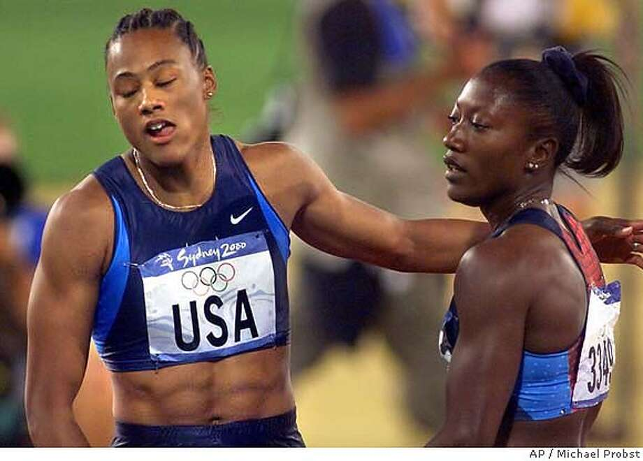 Marion Jones, of the U.S. women's 4 x 100 meter relay team, left, hugs teammate Chryste Gaines after their team won the bronze medal in the event at the Summer Olympics Saturday, Sept. 30, 2000, at Olympic Stadium in Sydney. (AP Photo/Michael Probst) DIGITAL IMAGE Photo: MICHAEL PROBST