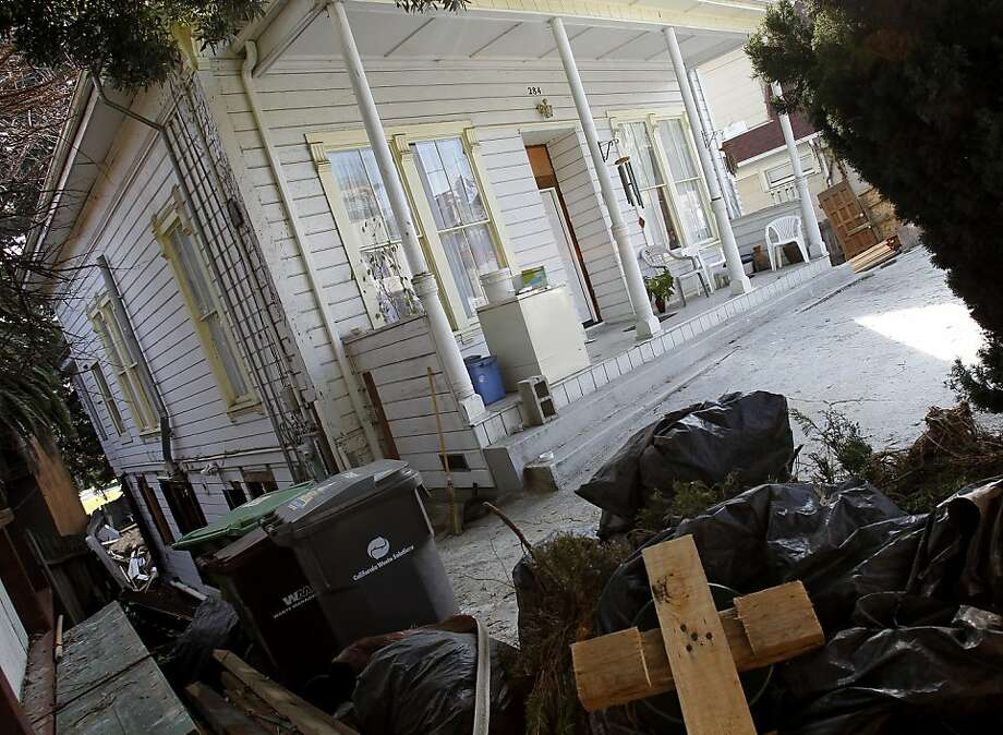 The home was undergoing extensive renovation. Some debris is stacked out in front. Friends and family members returned to the home at 284 Athol Avenue in Oakland, Calif. Sunday January 29, 2012 where two parents were allegedly killed by their son late last week. Photo: Brant Ward, The Chronicle