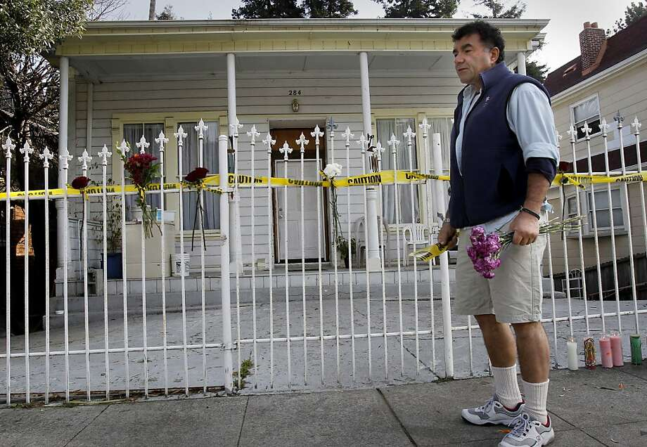 FILE-- Mike Arrajj, who knew the family, brings flowers to the home of Susan Poff and Robert Kamin on Athol Avenue in Oakland, where the parents were killed by their son Moses Kamin in January 2012. Photo: Brant Ward, The Chronicle