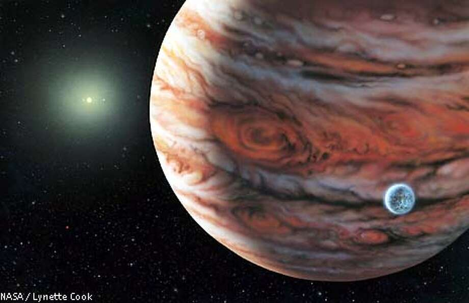 This is the first time planet-hunters have detected what they believe is a Jupiter-like gas ball orbiting a star much like our Sun, at a distance that allows for the possibility of an unseen Earth-type planet orbiting in between. This artist's conception released June 12, 2002 depicts a Jupiter-mass planet orbiting the star 55 Cancri, about 41 light years from Earth. A possible moon around the planet is shown (lower R) because such moons are thought to be common around this type of planet, but no moon has been detected. REUTERS/HO/NASA/Lynette Cook Photo: HO