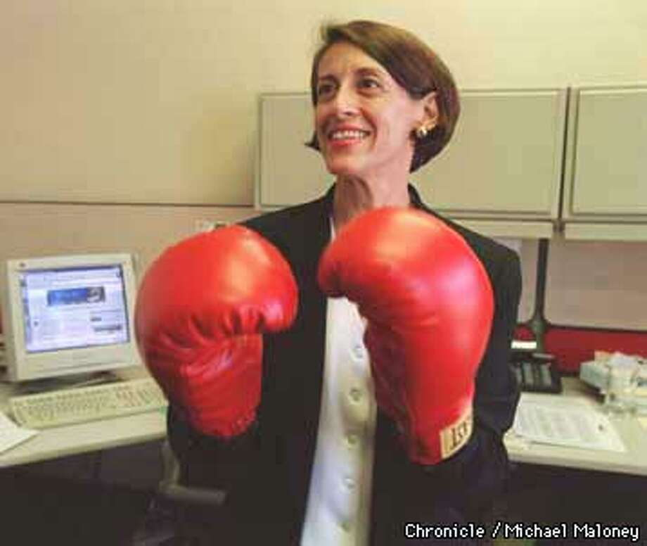 """When Roberta Katz arrived at Netscape for her first day as their general counsel, she was given a pair of boxing gloves by another lawyer to help in her """"fight"""" for Netscape. She now keeps the goves hanging near the doorway of her Mountain View office.  Photo by Michael Maloney Photo: MICHAEL MALONEY"""