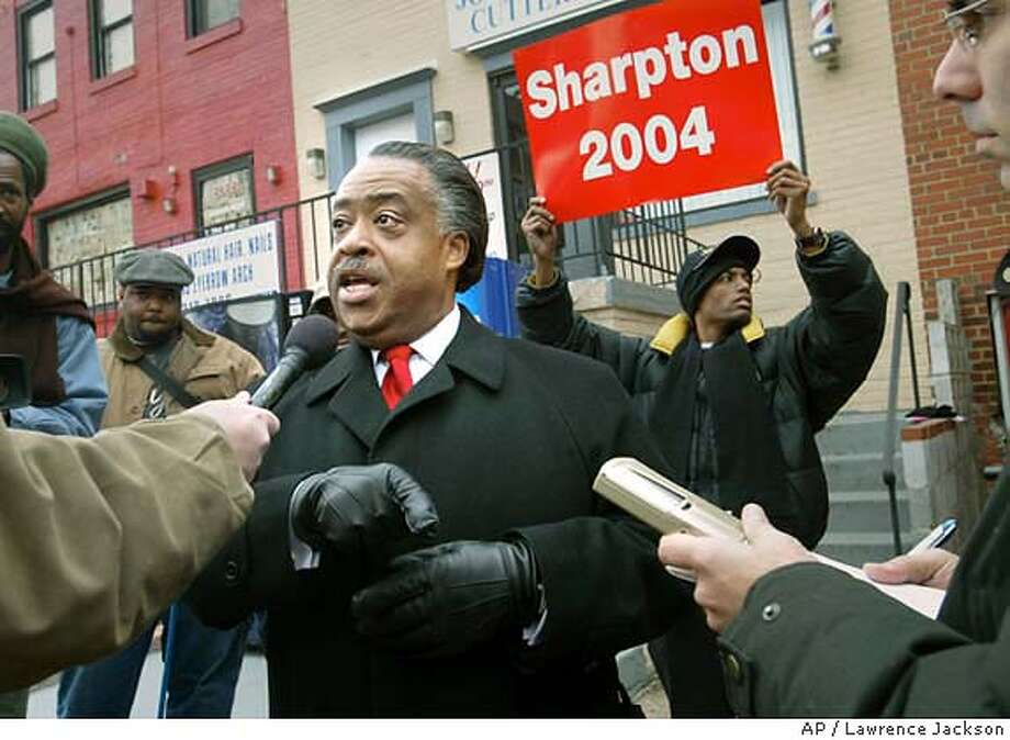 Democratic hopeful candidate, Rev. Al Sharpton, center, answers questions from the media, Monday, Jan. 12, 2004, in Washington. Rev. Sharpton is in town campaigning for the Democratic nomination for president and the Washington, D.C., primary which is being held Tuesday.(AP Photo/Lawrence Jackson) Nation#MainNews#Chronicle#1/17/2004##3star##0421564884 Photo: LAWRENCE JACKSON