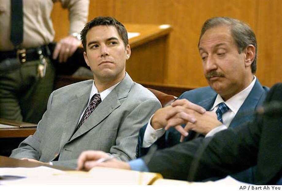 Scott Peterson, left, listens with his attorney, Mark Geragos, as prosecutor Rick Distaso, not shown, addresses the court Wednesday morning, Jan. 14, 2004, at Stanislaus County Superior Court in Modesto, Calif. Peterson is charged with murdering his wife, Laci Peterson, and unborn son. (AP Photo/Bart Ah You, pool) POOL IMAGE Photo: BART AH YOU