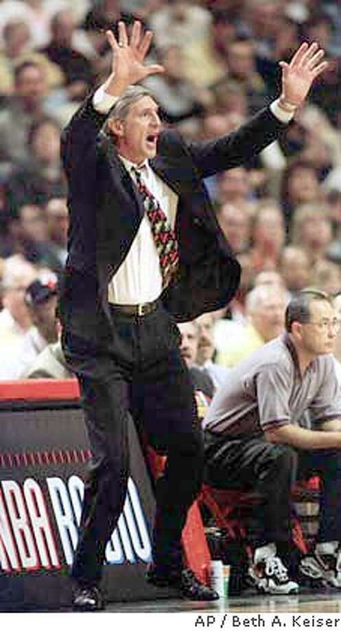Utah Jazz head coach Jerry Sloan tries to calm his team down in the third quarter of Game 1 of the NBA Finals against the Chicago Bulls Sunday, June 1, 1997, in Chicago. The Jazz lost to the Bulls 84-82. (AP Photo/Beth A. Keiser) Photo: BETH A. KEISER