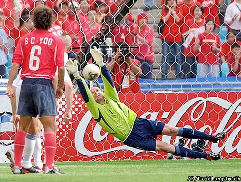 USA's goalkeeper Brad Friedel stops a freekick during the South Korea versus USA, Group D, 2002 World Cup soccer match at the Daegu World Cup Stadium in Daegu, South Korea, Monday June 10, 2002. The other teams in Group D are Poland and Portugal. (AP Photo/David Longstreath) Photo: DAVID LONGSTREATH