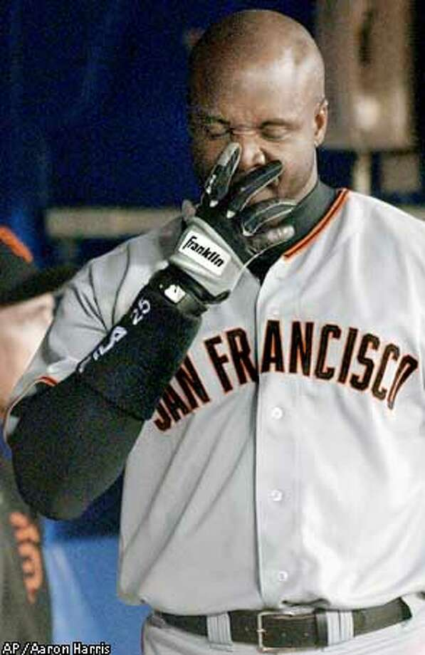 San Francisco Giants' Barry Bonds walks through the dugout after striking out swinging during the ninth inning of play against the Toronto Blue Jays in Toronto Monday, June 10, 2002. The Blue Jays beat the Giants 6-5. (AP Photo/Aaron Harris) Photo: AARON HARRIS
