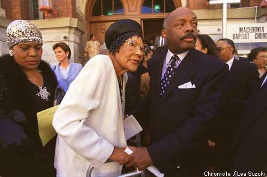 """From Right: Willie Brown, Eugenia Jones of San Mateo, CA., Mildred Burrell, of San Francisco, CA. Brown talks with Jones, an old friend of the family who used to work with Rembert """"Itsie"""" Collins, in front of the Macedonia Baptist Church on Sutter St. after the memorial service for Brown's uncle. Photo by Lea Suzuki Photo: LEA SUZUKI"""