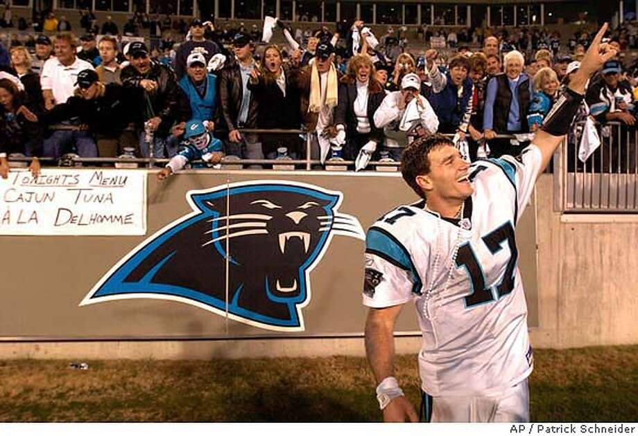 Carolina Panthers quarterback Jake Delhomme raises his hand into the air after shaking hands with fans following the team's 29-10 victory over the Dallas Cowboys, Saturday, Jan. 3, 2004, in Charlotte, N.C. (AP Photo/The Charlotte Observer, Patrick Schneider) MAGAZINES OUT, Photo: PATRICK SCHNEIDER