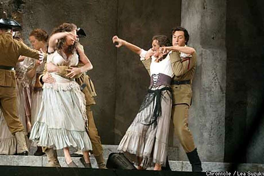"Marina Domashenko in the title role and Richard Berkeley-Steele as Don Jose (right) with Valentina Simi as Manuelita (left) in ""Carmen."" Chronicle photo by Lea Suzuki"