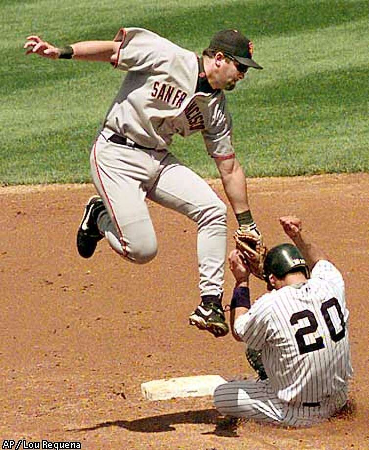 Rich Aurilia appeared to tag out the Yankees' Jorge Posada on a fourth-inning steal attempt, but Posada was ruled safe. Associated Press photo by Lou Requena