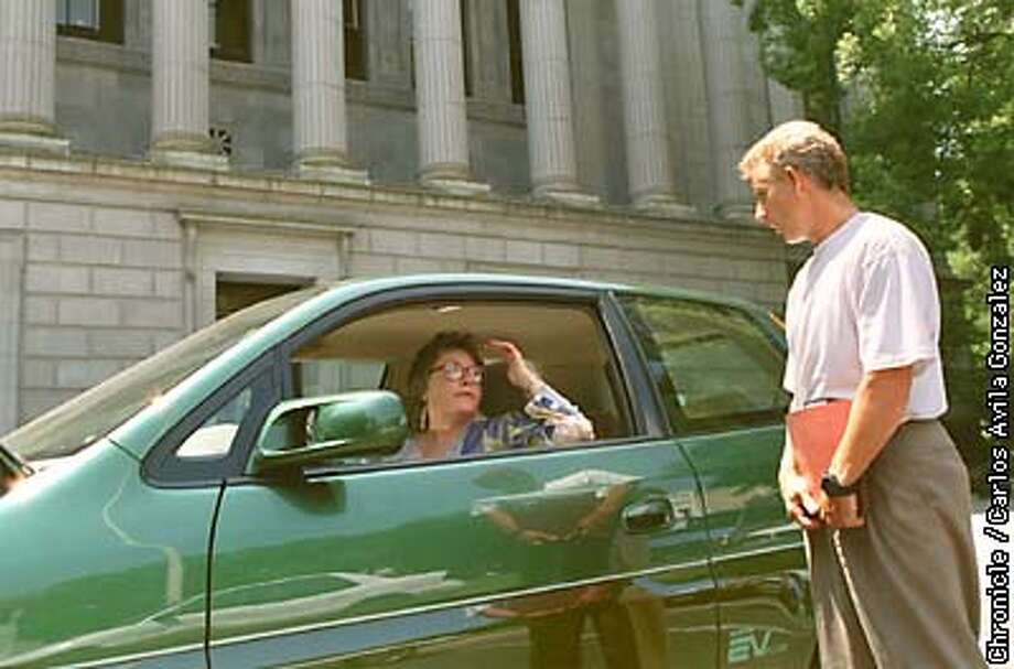 Martha Schwartzmann, a research attorney with the 3d District Court of Appeals in Sacramento, chats with Pat Waltz about her electric car outside the Court of Appeals in Sacramento on Thursday, August 7, 1997. Schwartzmann's car, a Honda EV Plus, draws onlookers and those curious about the alternative fuel vehicle. CHRONICLE PHOTO BY CARLOS AVILA GONZALEZ Photo: Carlos Avila Gonzalez