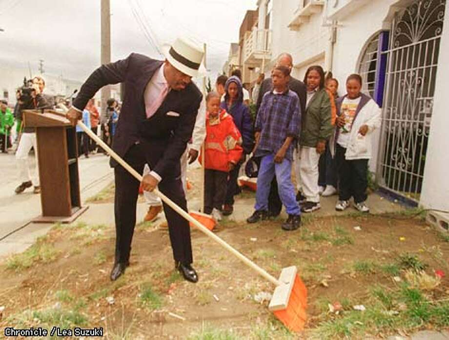 Mayor Brown sweeps up in front of a home on Fitzgerald St. in San Francisco yesterday after announcing the grant awards for community beautification projects. Photo By Lea Suzuki