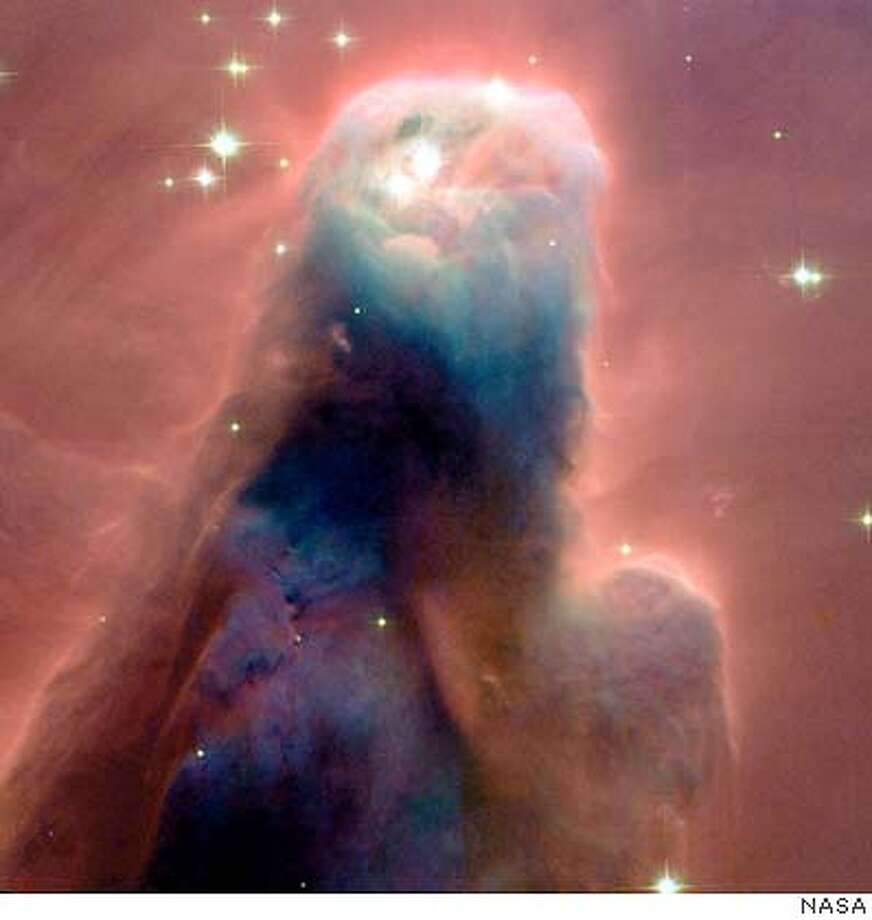 "THIS IS A HANDOUT IMAGE. PLEASE VERIFY RIGHTS. HUBBLECONE-C-26DEC02-MN-HO  The Hubble telescope imaged the ""Cone Nebula,"" a craggy-looking mountaintop of cold gas and dust that is a cousin to Hubble's iconic ""pillars of creation"" in the Eagle Nebula, photographed in 1995.  NASA PHOTO Photo: NASA"