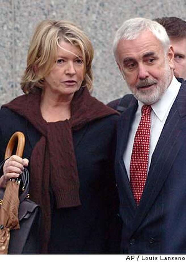 and her lawyer John Tigue leave U.S District Court,Tuesday, Nov. 18, 2003, in New York. U.S District Judge Miriam Goldman Cedarbaum on Tuesday refused to dismiss a securities fraud charge that accuses of deceiving her stockbrokers when she publicly declared her innocence in the insider-trading scandal. (AP Photo/ (Louis Lanzano) Photo: LOUIS LANZANO