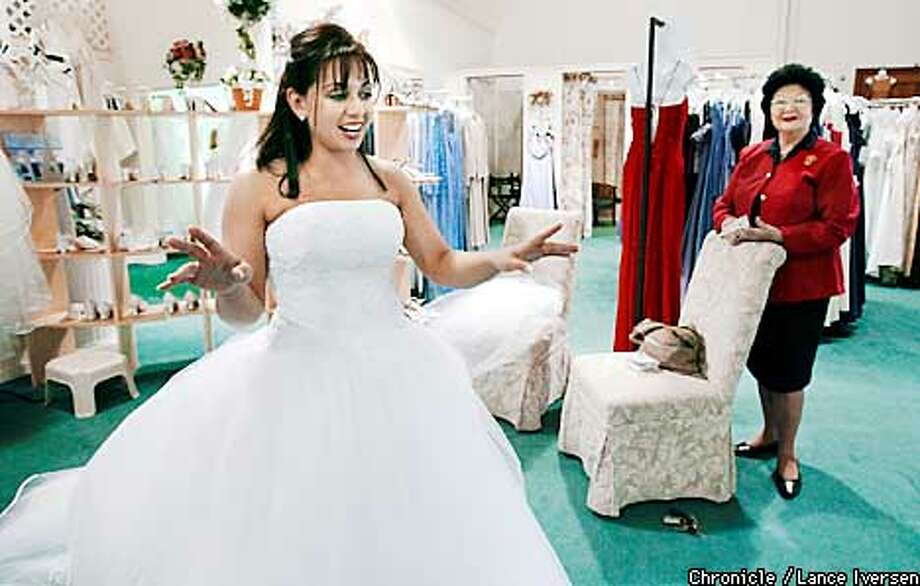 Cristina Spinardi from Danville gets her final fitting one week before her spring wedding with Erik Przekop at Kay's Bridle in Castro Valley. Her grandmother Lena Spinardi looks on. ( THEME IS ---SOMETHING BORROWED, SOMETHING BLUE, SOMETHING OLD & SOMETHING NEW. Her new item is her wedding dress. BY LANCE IVERSEN/SAN FRANCISCO CHRONICLE Photo: LANCE IVERSEN