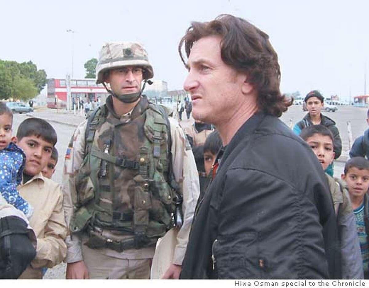 American actor Sean Penn greets school children in Baghdad. Photographer: Hiwa Osman