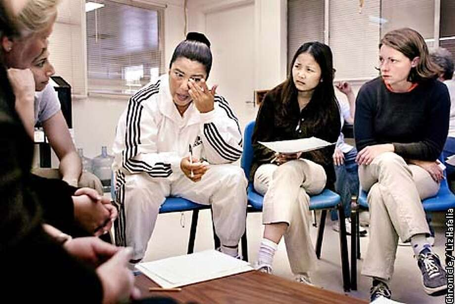 SUAREZ-C-20MAY02-MT-LH--Maria Suarez talking about her experience being battered and convicted. To the right of her is Daisy Carreon (next to her) and Michela Woodbridge (right)--both visiting from UCLA from the school of public health taking a violence prevention course.  (PHOTOGRAPHED BY LIZ HAFALIA/THE SAN FRANCISCO CHRONICLE)