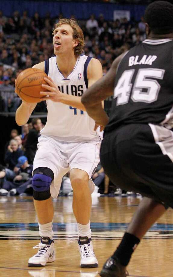 Dallas Mavericks forward Dirk Nowitzki (41) looks to shoot as San Antonio Spurs forward DeJuan Blair (45) watches during the first half of an NBA basketball game in Dallas, Sunday, Jan. 29, 2012. (AP Photo/LM  Otero) Photo: Associated Press