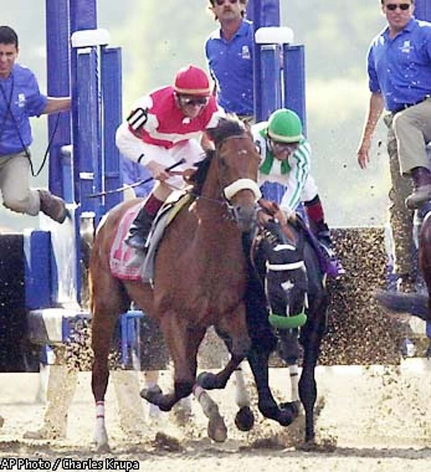 War Emblem, right, with Victor Espinoza up, stumbles out of the starting gate with Magic Weisner (11) and jockey Richard Migliore during the start of the 134th , in Elmont, N.Y., Saturday, June 8, 2002. (AP Photo/Charles Krupa) Photo: CHARLES KRUPA