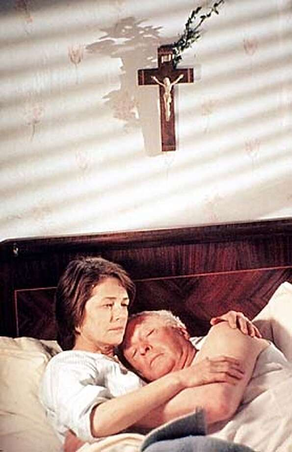 "charlotte rampling as NICOLE AND MICHAEL CAINE AS PIERRE BROSSARD IN ""THE STATEMENT,"" DIRECTED BY NORMAN JEWISON"
