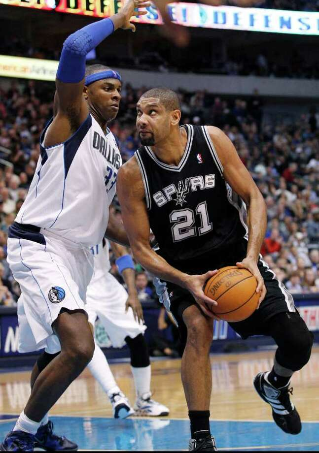 San Antonio Spurs center Tim Duncan (21) looks to shoot against Dallas Mavericks center Brendan Haywood (33) during the second half of an NBA basketball game in Dallas, Sunday, Jan. 29, 2012. The Mavericks won 101-100 in overtime. (AP Photo/LM  Otero) Photo: Express-News