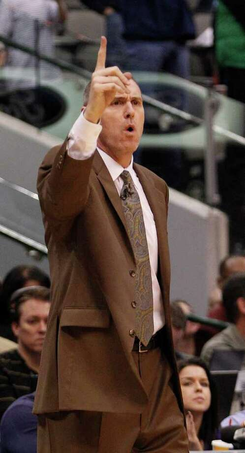 Dallas Mavericks coach Rick Carlisle calls a play during the second  half of an NBA basketball game against the San Antonio Spurs in Dallas, Sunday, Jan. 29, 2012. The Mavericks won 101-100 in overtime. (AP Photo/LM  Otero) Photo: Express-News