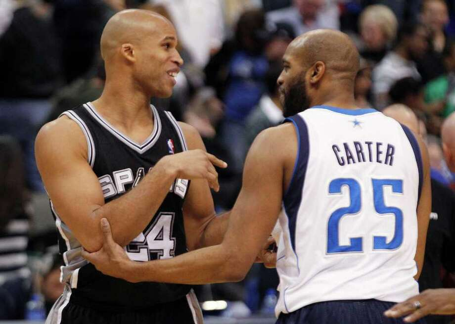 San Antonio Spurs forward Richard Jefferson (24) and Dallas Mavericks guard Vince Carter (25) greet each other after an NBA basketball game in Dallas, Sunday, Jan. 29, 2012. The Mavericks won 101-100. (AP Photo/LM  Otero) Photo: Express-News