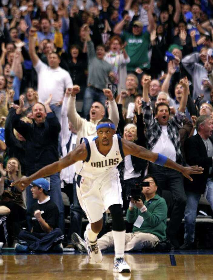 Dallas Mavericks guard Jason Terry (31) spreads his arms as the crowd cheers after Terry scored, forcing overtime in an NBA basketball game against the San Antonio Spurs in Dallas,  Sunday, Jan. 29, 2012.  The Mavericks won 101-100.  (AP Photo/LM  Otero) Photo: Express-News