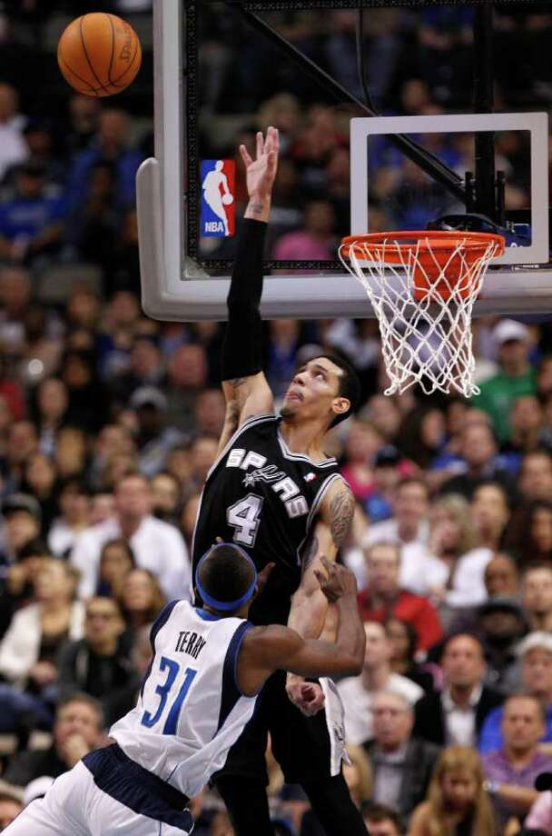 San Antonio Spurs guard Daniel Green (4) tries to block a shot by Dallas Mavericks guard Jason Terry (31) during the second half of an NBA basketball game in Dallas,  Sunday, Jan. 29, 2012.  The Mavericks won in overtime. 101-100.  (AP Photo/LM  Otero) Photo: Express-News