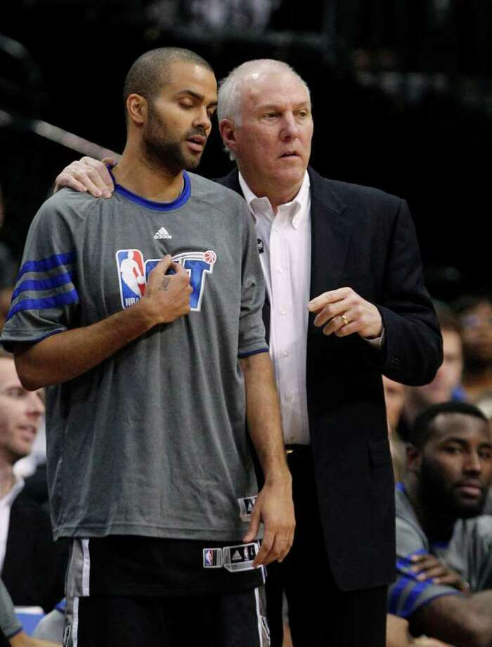 San Antonio Spurs point guard Tony Parker (9) closes his eyes and listens to coach Gregg Popovich during the second half of an NBA basketball game against the Dallas Mavericks in Dallas, Sunday, Jan. 29, 2012. The Mavericks won 101-100 in overtime. (AP Photo/LM  Otero) Photo: Express-News