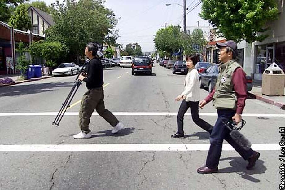 Akira Matsubara, Director; Yumi Sasaki, Co-director; Yoshiyuki Mutsuda, camera man. A Japanese community-activist documentary film company is doing a film of Berkeley as a paragon of American community involvement and activism. The city probably has the highest per capita ratio of citizen commissions in the nation. Lately Berkeley has become something of an American Mecca for the Japanese peace movement because of the city's stands against the Afghan bombing and sanctions against Iraq. The film will be shown to schools and community groups back in Japan. The Berkeley organizer for their filming is Berkeley Peace and Justice Commissioner Steve Freedkin. Photo By Lea Suzuki/San Francisco Chronicle Photo: LEA SUZUKI