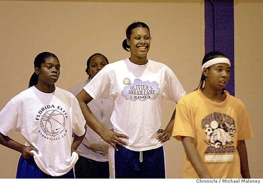 Oakland Tech girls basketball star Devanei Hampton is a 6-3 junior phenom - among the top-ranked in the nation. She towers above her teammates  Event on 1/7/04 in Oakland.  Michael Maloney / The Chronicle Photo: Michael Maloney