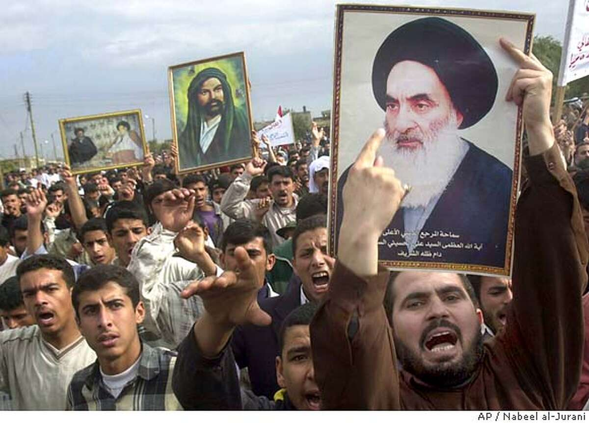 Iraqis protest in the streets of the southern city of Basra carrying posters of Shiite leaders including Grand Ayatollah Ali al-Husseini al-Sistani , far right, the top cleric of Iraq's Shiite majority Thursday Jan. 15, 2004. Thousands demonstrated in Basra to support al-Sistani's demands for an interim legislature to be elected directly, not chosen in provincial caucuses as called for under political agreement signed between L. Paul Bremer, America's top civilian official in Iraq, and the Iraqi Governing Council. (AP Photo/Nabeel al-Jurani)
