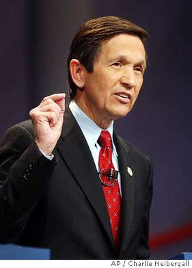 Democratic presidential hopeful Dennis Kucinich answers questions during a debate in Johnston, Iowa, Sunday, Jan. 4, 2004. (AP Photo/Charlie Neibergall) Photo: CHARLIE NEIBERGALL