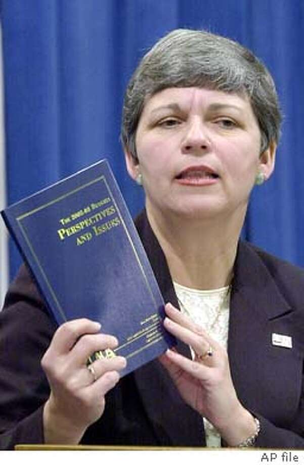 Legislative Anaylist Elizabeth Hill holds up a summary of the 2002 state budget analysis prepared by her office during a news conference held at the Capitol in Sacramento, Calif., Wednesday, Feb. 20, 2002. Hill said that even if Gov. Gray Davis' adjustments are made in his proposed budget, the state is still facing a deficit of at least $5 billion more than anticipated. (AP Photo/Rich Pedroncelli) CAT DIGITAL IMAGE Photo: RICH PEDRONCELLI