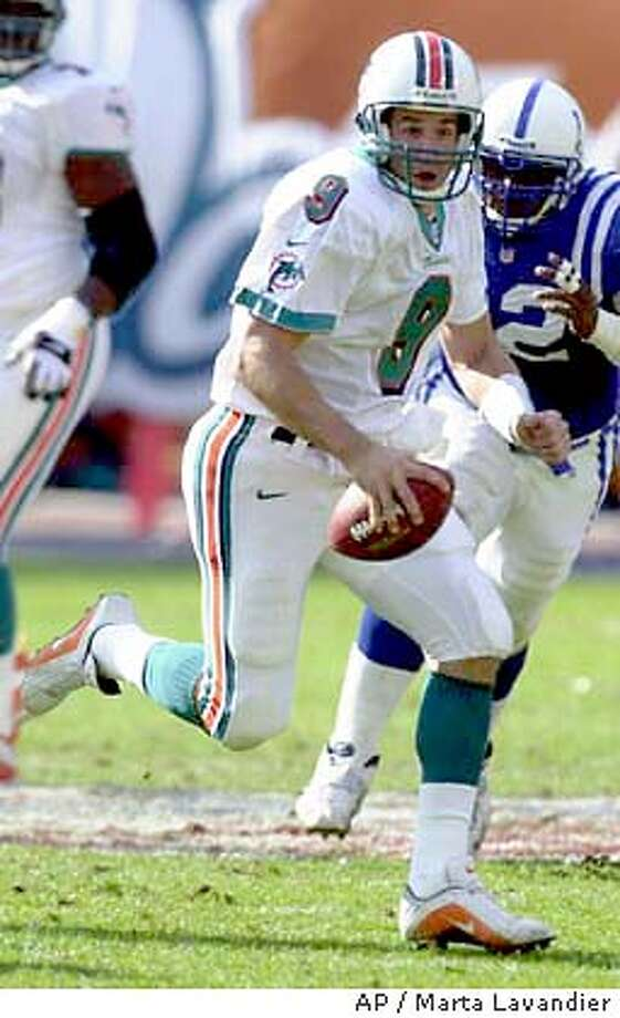 Miami Dolphins quarterback Jay Fielder (9) runs for yardage during second half action against the Indianapolis Colts at Pro Player Stadium in Miami, Saturday Dec. 30, 2000. The Dolphins defeated the Colts 23-17 in overtime to advance to the AFC divisional game. (AP Photo/Marta Lavandier) DIGITAL IMAGE Photo: MARTA LAVANDIER