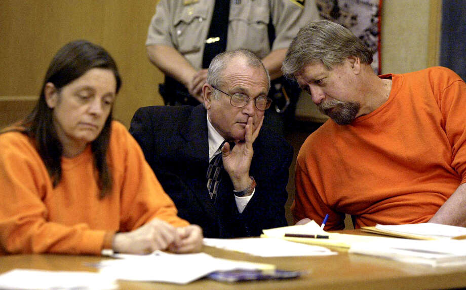Robert Noel, right, confers with his attorney, Bruce Hotchkiss, center, as Marjorie Knoller listens to arguements for a new trial before a scheduled sentecning hearing in San Francisco Superior court Friday June 7, 2002 in San Francisco. Noel was convicted of involuntary manslaughter, and Knoeller was convicted of second degree murder on charges stemming from the grizzly dog mauling death of their neighbor, Diane Whipple.(AP Photo/John G. Mabanglo) Photo: JOHN G. MABANGLO