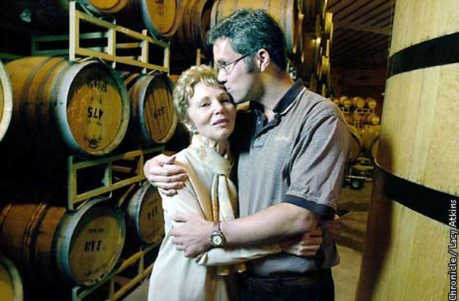 Jamie Davis gets a kiss from her son Hugh, who is taking over the Schramsberg Yineyard, from his mother, in Calistoga.  PHOTO BY LACY ATKINS/CHRONICLE Photo: Lacy Atkins