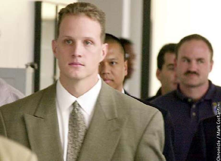 "RIDERS07b-C-06DEC00-EZ-MC. Matt Hornung, an Oakland cop and part of a group known as ""The Riders,"" leaves Alameda County Superior Court in Oakland today. Photo by Mark Costantini/Chronicle ALSO RAN 5/31/2001, 4/29/02"