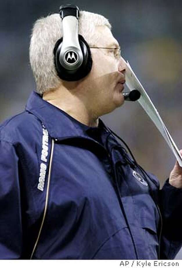 St. Louis Rams' coach Mike Martz covers his face during their 29-23 loss to the Carolina Panthers' for the Conference Semifinals playoff game on Saturday, Jan. 10, 2003, at the Edward Jones Dome in St. Louis (AP Photo/Kyle Ericson) Photo: KYLE ERICSON