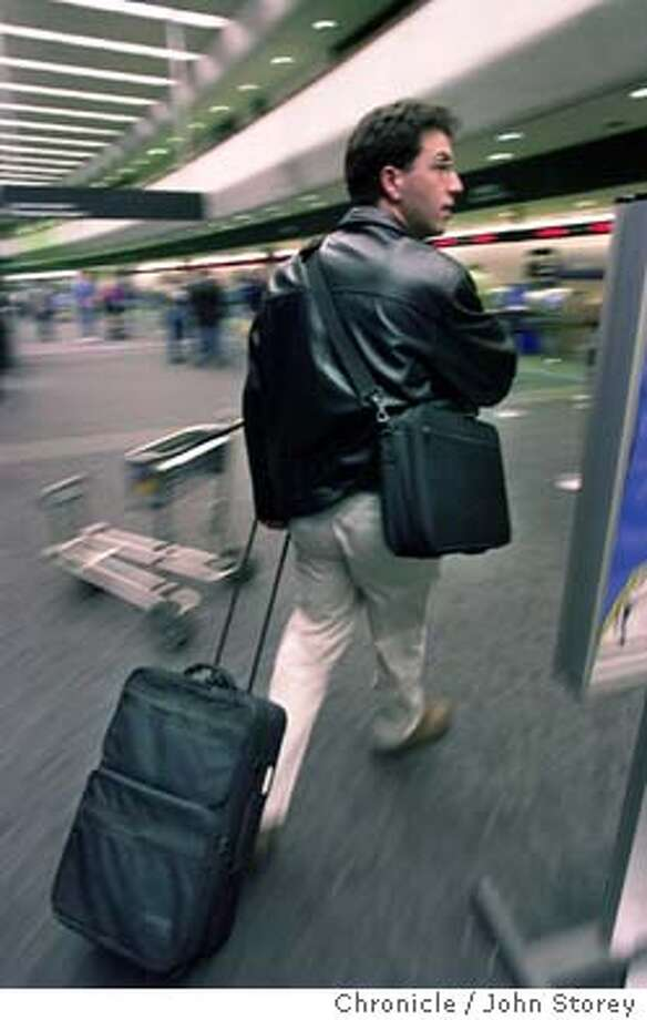 Story about the coding of airline passengers for security purposes. They would be coded red, yellow or green depending on background checks. Sam Schaevitz of Fremont about to go through security.  1/12/04 in San Bruno. John Storey / The Chronicle Photo: John Storey