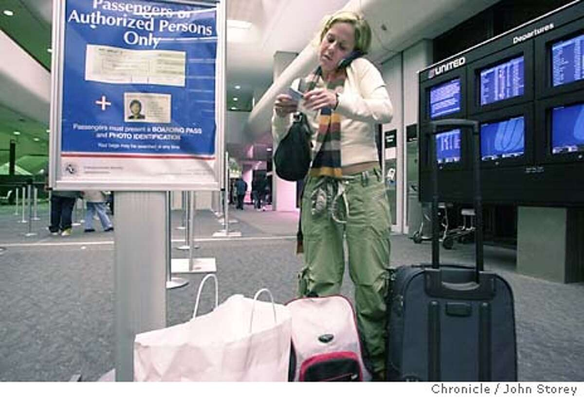 Story about the coding of airline passengers for security purposes. They would be coded red, yellow or green depending on background checks. Shelby Hicklin of Los Angeles talks on her phone before going through security. 1/12/04 in San Bruno. John Storey / The Chronicle