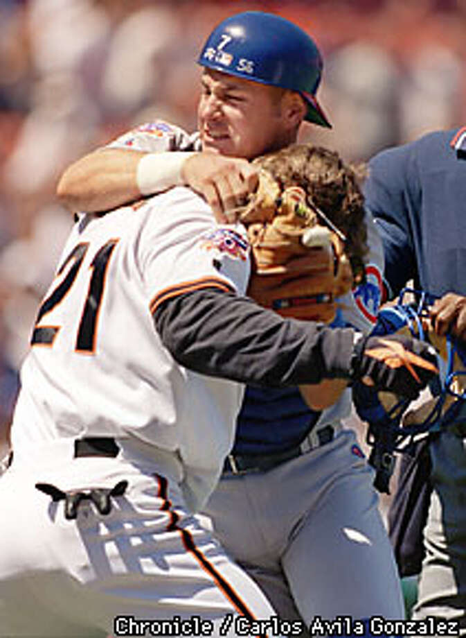 Chicago Cubs catcher Tyler Houston, (7), grabs onto Giants Jeff Kent, (21), during a scuffle in the bottom of the fourth inning after Kent was hit by a pitch on Wednesday, August 13, 1997. Both Kent and Houston were ejected from the game following the brawl that emptied both benches. CHRONICLE PHOTO BY CARLOS AVILA GONZALEZ Photo: CARLOS AVILA GONZALEZ
