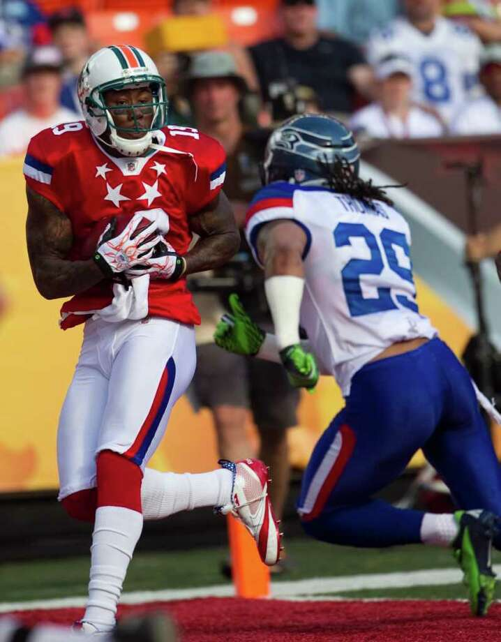 Miami Dolphins wide receiver Brandon Marshall (19) of the AFC pulls in a touchdown over Seattle Seahawks free safety Earl Thomas (29) of the NFC during the second quarter of the NFL Pro Bowl football game at Aloha Stadium, Sunday, Jan. 29, 2012 in Honolulu. Photo: AP