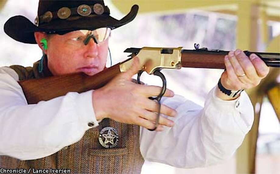 Richard ( Tequila ) Young is five time modern Class World Champion as he demonstrates the sport of cowboy shooting at the national Shooting Sports Foundations seminar at Chabot Gun Club in Castro Valley. BY LANCE IVERSEN/SAN FRANCISCO CHRONICLE Photo: LANCE IVERSEN